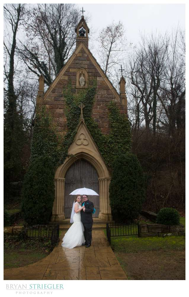 Fayetteville Wedding Photographer bride and groom with umbrella in front of St. Catherine's