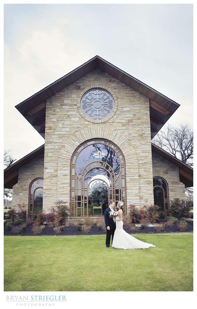 Arkansas Winter Wedding couple in front of chapel