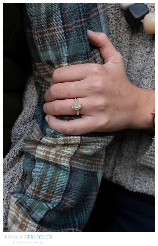 showing off engagement ring