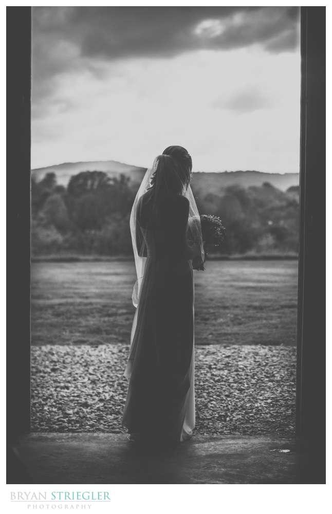 silhouette of bride in barn doorway