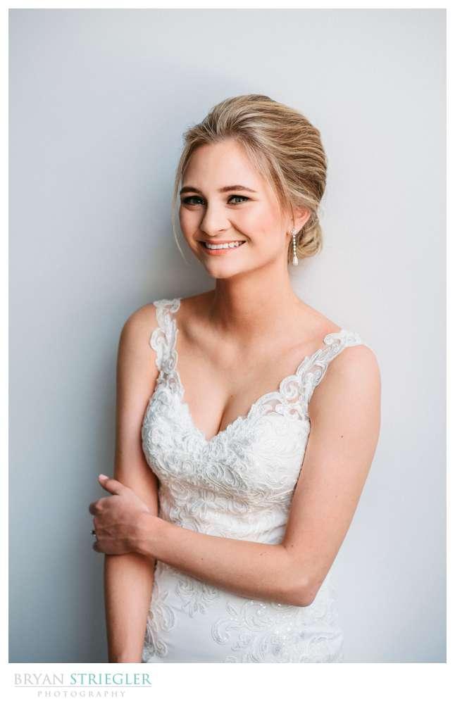 bridal portraits against a white wall