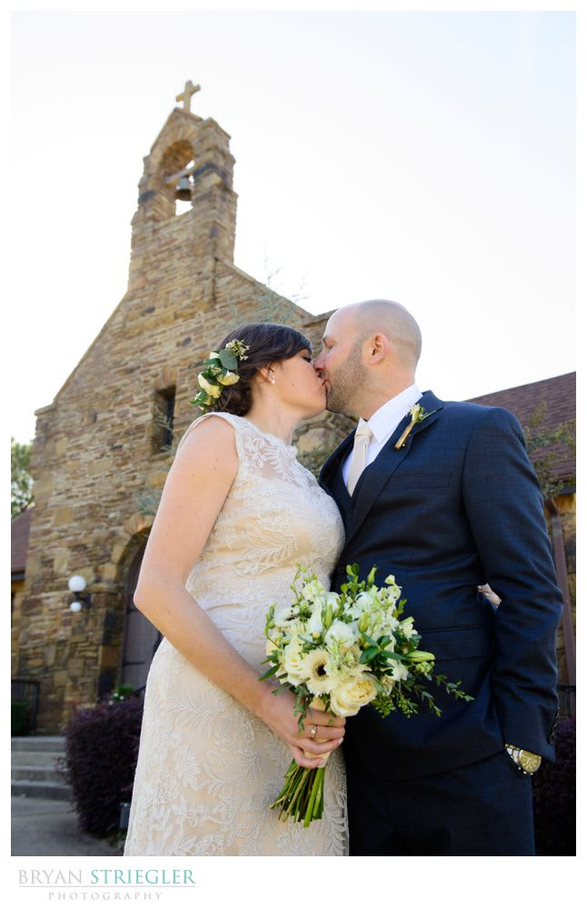 couple kissing in front of church in ft. Smith