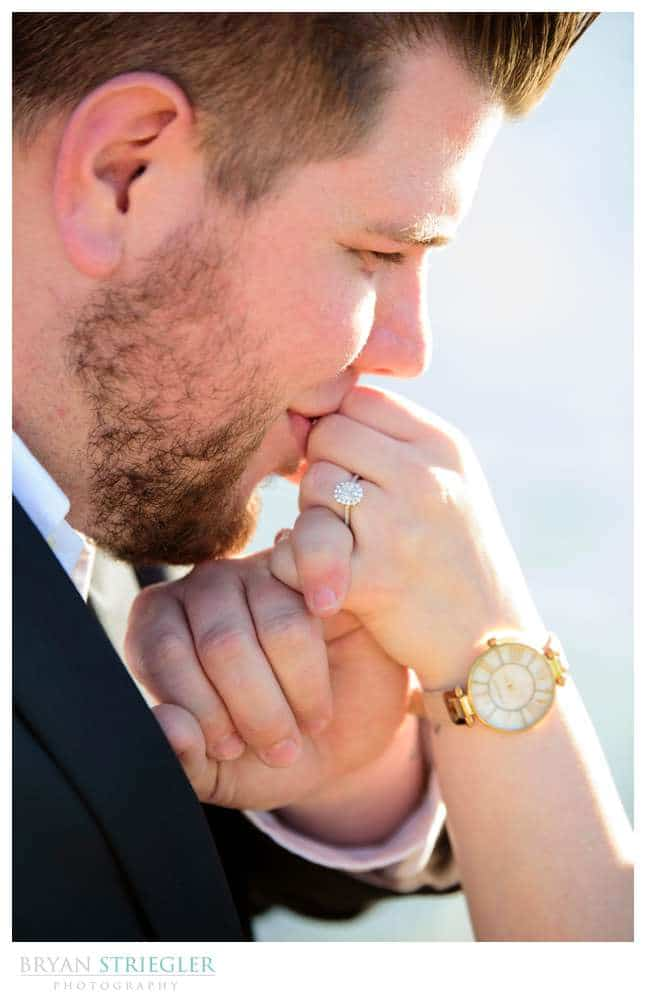 kissing hand with engagement ring