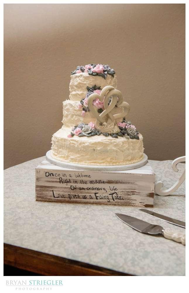 wedding cake with wood sign