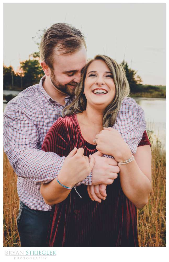 hugging and laughing engagement photos