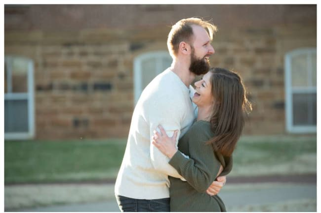 laughing and hugging engagement photo