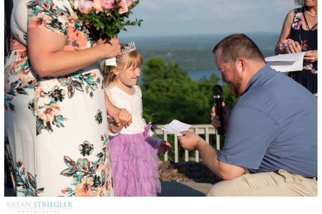 groom giving daughter special gift