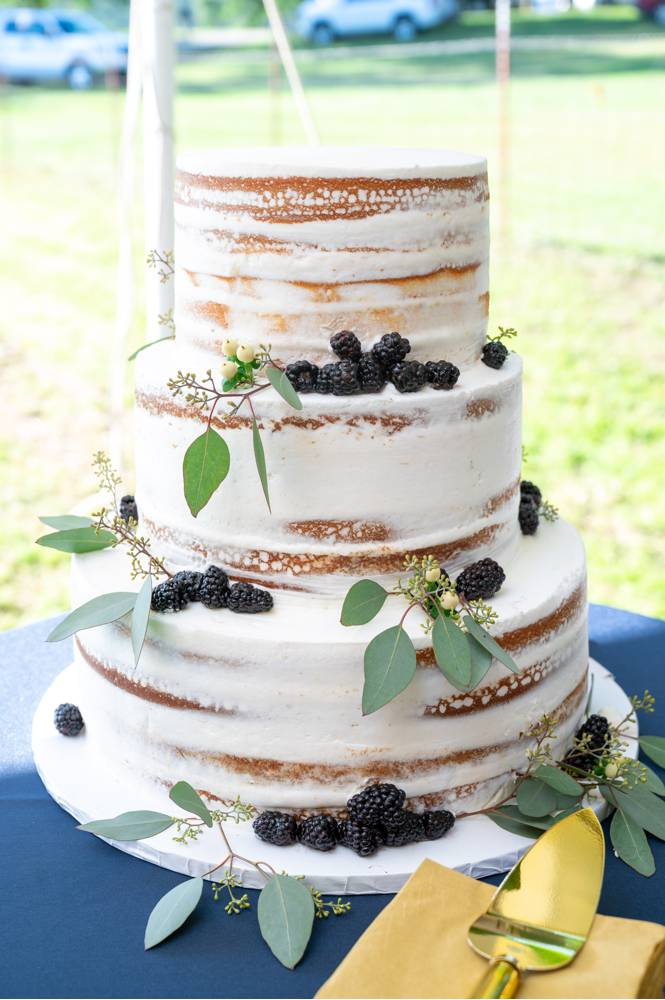 lightly frosted wedding cake with blackberries