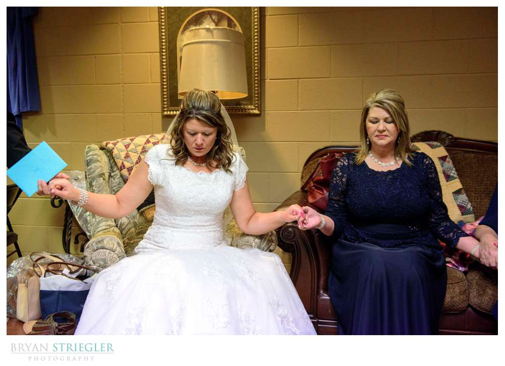 bride praying with family