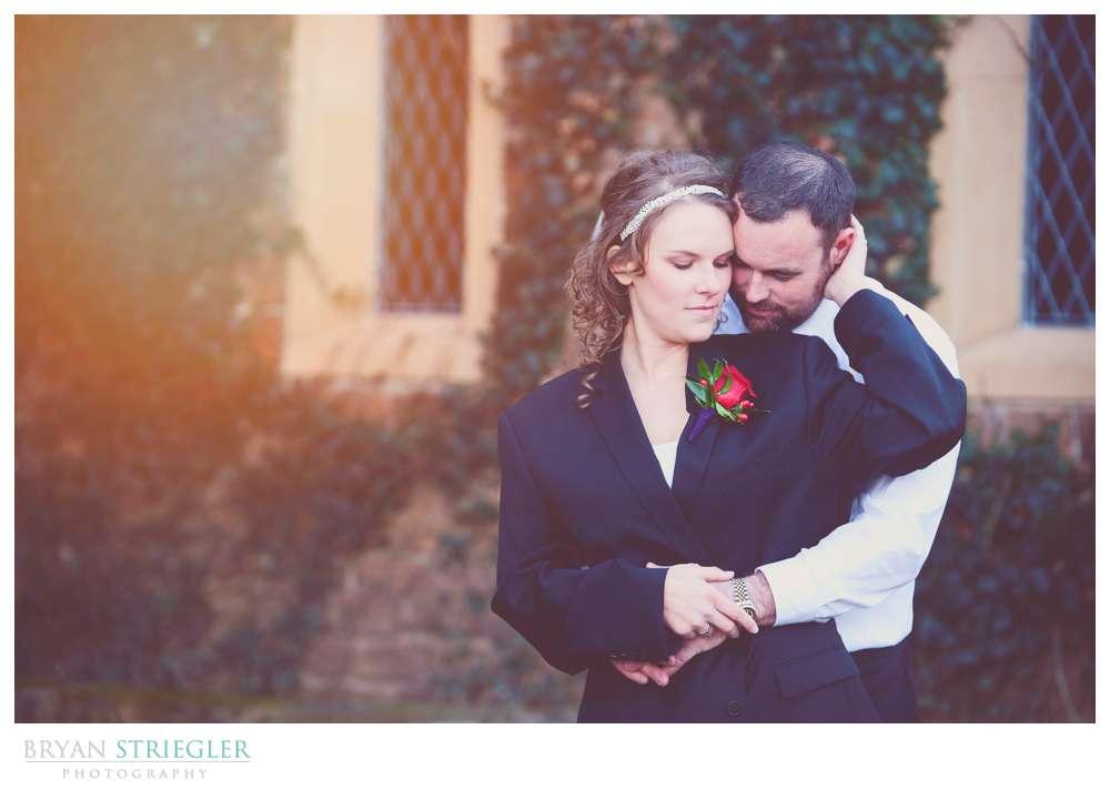 Fayetteville Wedding Photographer bride with groom's coat