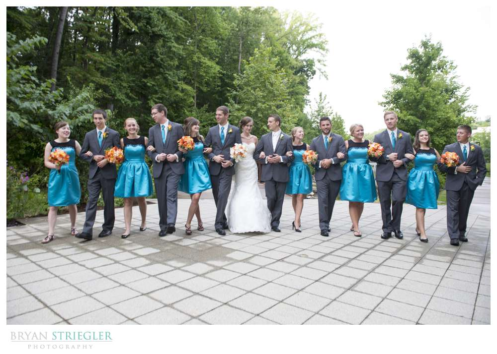 Northwest Arkansas Wedding Photographers bridal party walking