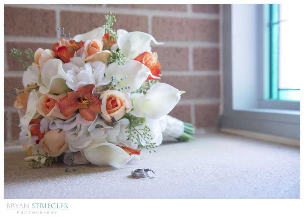 Northwest Arkansas Wedding Photographers flowers and rings