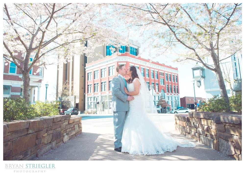 Fayetteville, Arkansas wedding couple kissing under trees