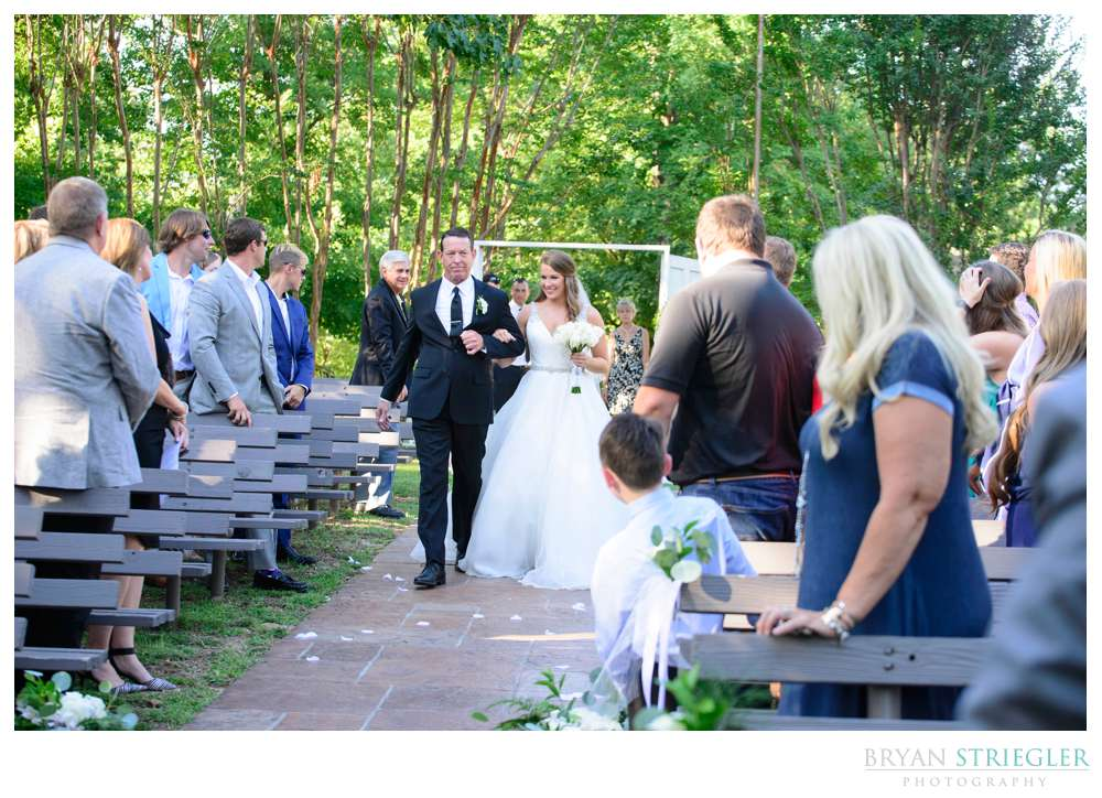 bride entering through the doors and walking down the aisle at a Mount sequoyah Wedding