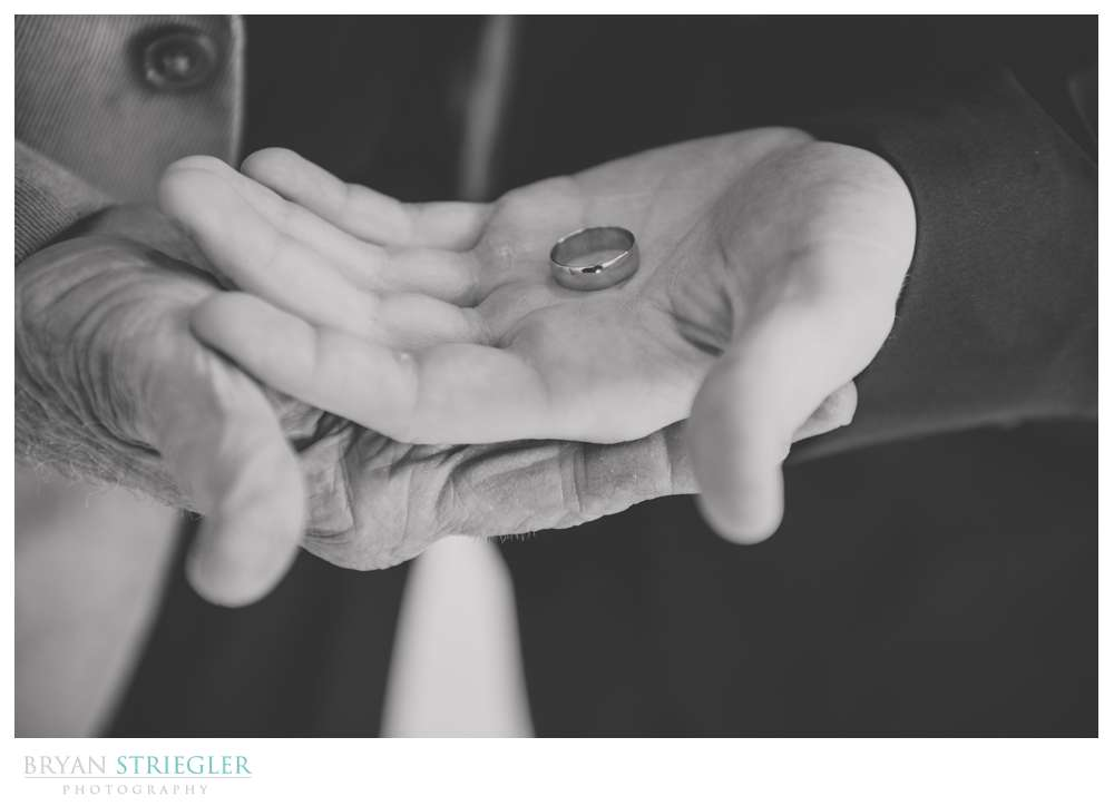 Holding wedding rings with grandfather