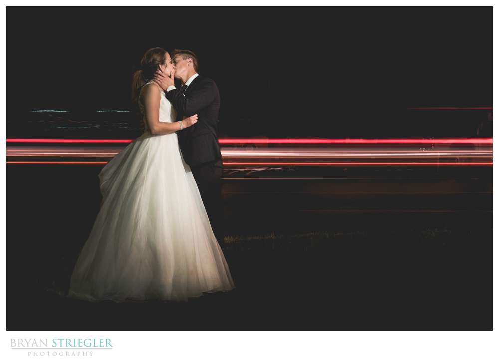 Long exposure wedding photo with cars