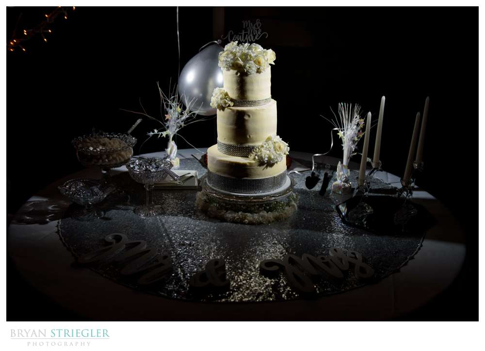 Wedding cake with balloons and a sign