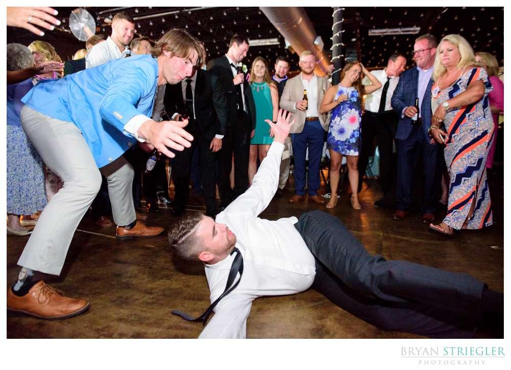 crazy wedding dancing on the floor