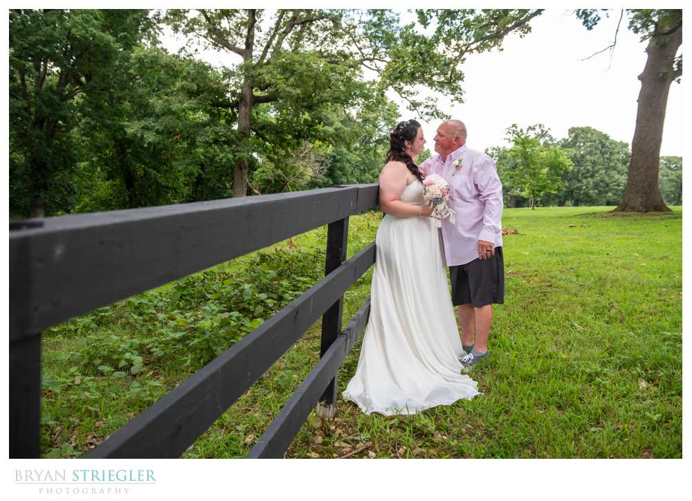 wedding portraits against fence