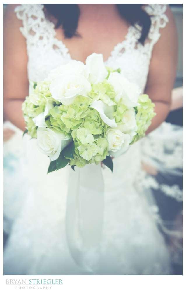 Fayetteville, Arkansas wedding bride holding bouquet
