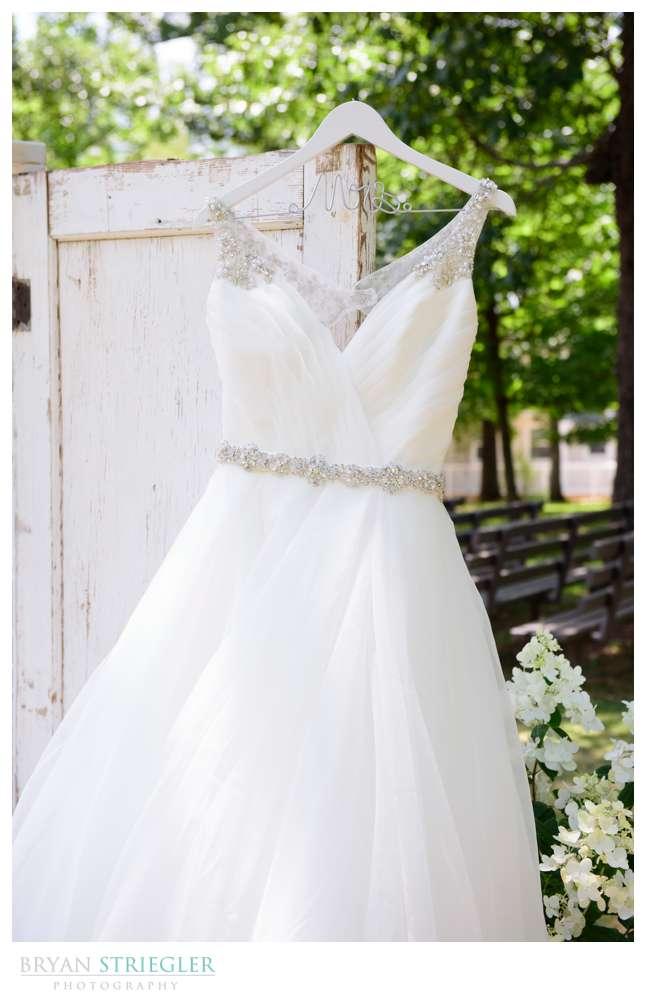Wedding dress hanging on a door outside