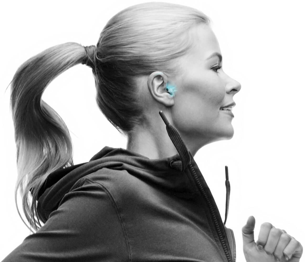 Woman running with Horizon hearing aids