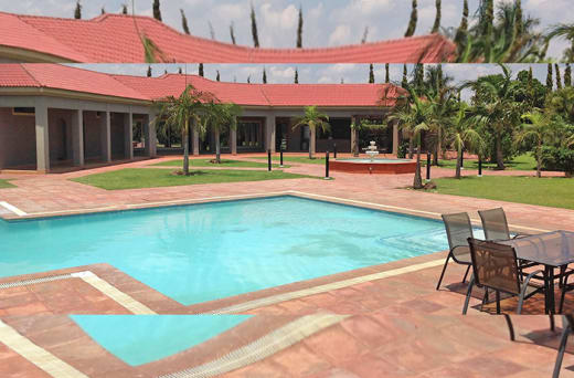 A very inspiring environment with swimming pool and tennis court