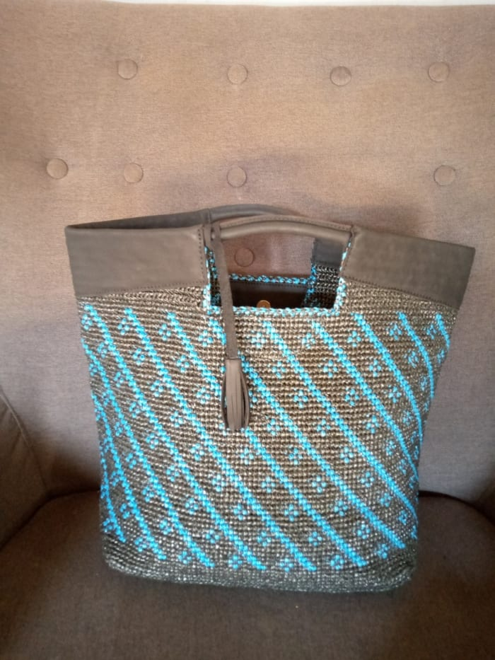 Gift yourself, family and friends with a range of bags made from recycled plastic and leather