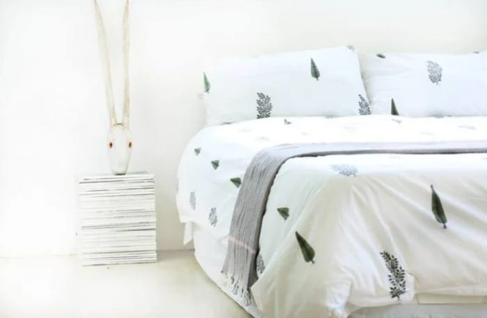 Hand embroidered bedding, cushions and table cloths