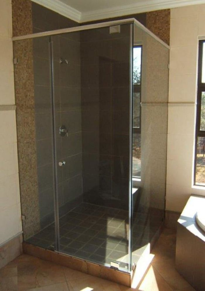 Aluminium framed shower enclosures in either natural anodized or white