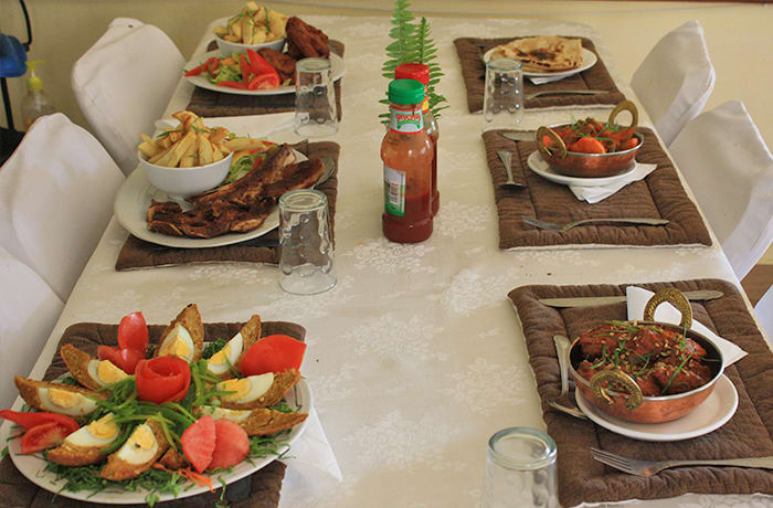 Variety of meals including traditional Zambian food, Indian cuisine and Western dishes