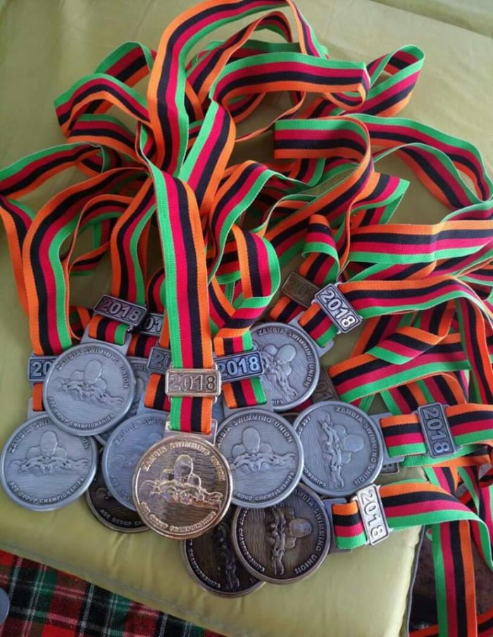 Trident students win 47 medals in swimming competition
