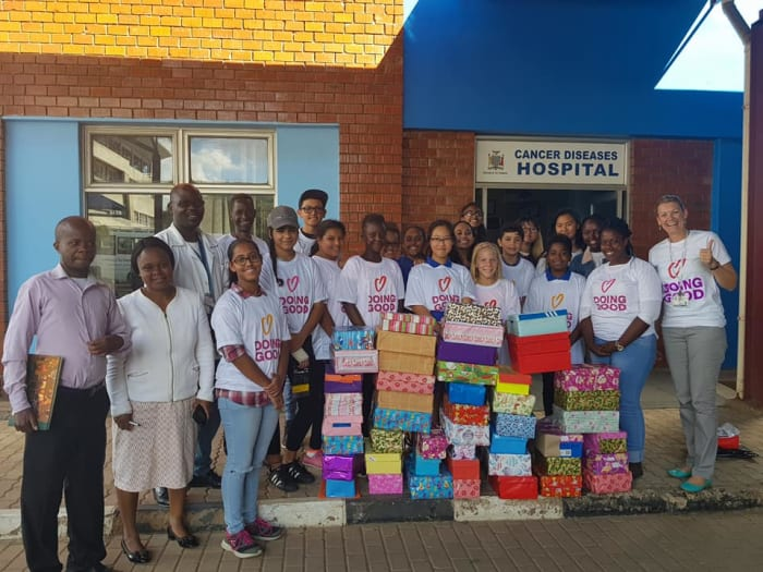 Students deliver shoe boxes to Cancer Diseases Hospital