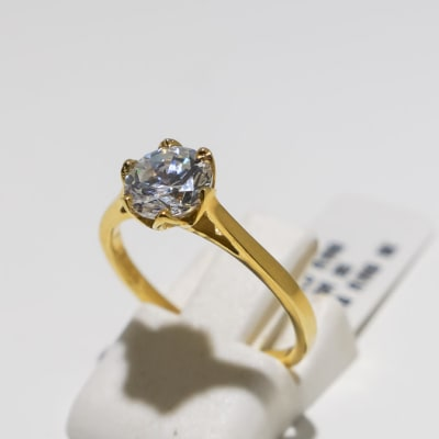 Elegant classic solitaire engagement yellow gold 9k and crystal ring image