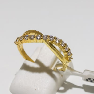 Engagement yellow gold and crossed band diamond ring image