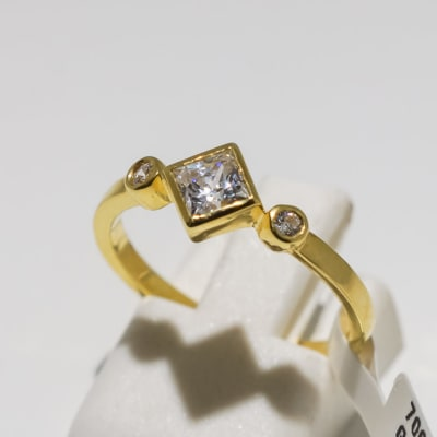 Engagement yellow gold 9k and crystal ring with square gem and two crystals image