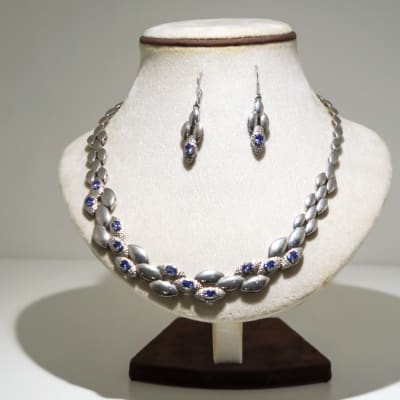 Silver and white gold plated petals with tanzanite gemstones necklace and  earring set  image