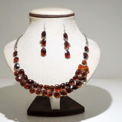 Silver oval garnet gem earring and necklace set image
