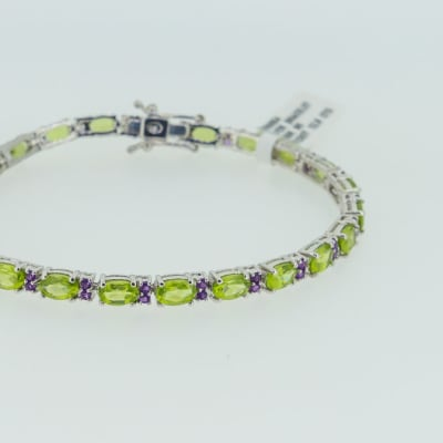 Silver linked chain peridot and amethyst bracelet image
