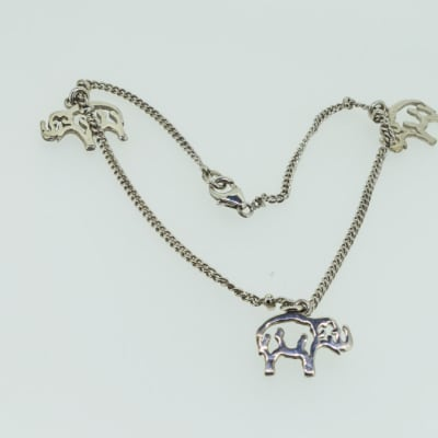 Silver necklace with elephants image