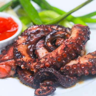 Tapas Style Small Dishes - Octopus in Herb Wine Sauce image