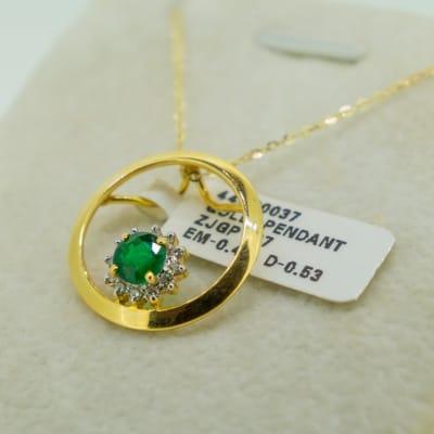 Yellow gold 14k emerald and diamond pendant  image