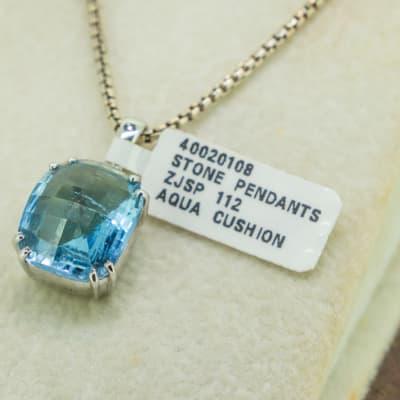 Aqua cushion and silver light blue stone pendant image