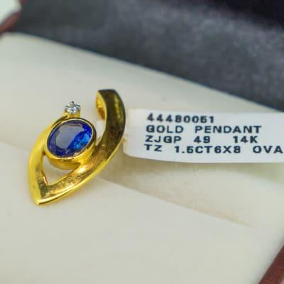 Yellow gold 18k and tanzanite with diamond pendant image