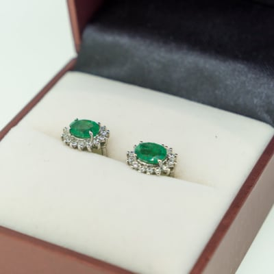 Silver, white gold plated, oval shaped emerald surrounded with swarovski crystal earrings  image