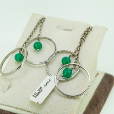 Emerald earrings on silver rings image