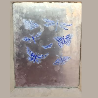 Glass pane with blue butterflies and dragonflies image