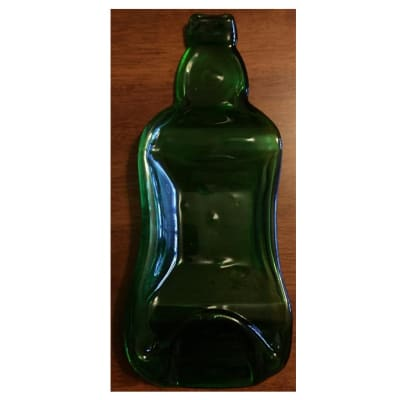 Green flattened paper weight bottle image