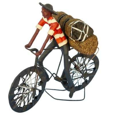 Toy Bicycle  Man Carrying  Bag of Charcoal Sculpture image