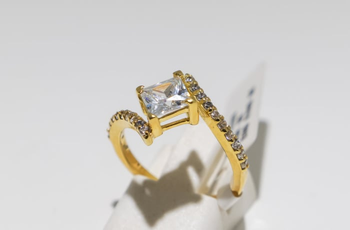 Engagement yellow gold 9k , crown, tension setting and crystals ring